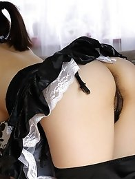 Sexy maid Yuri shos her booty and hairy pussy