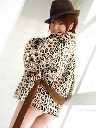 Hitomi Oda Asian on high heels boots takes leopard like coat off