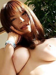 Enchanting gravure idol babe melts the heart with her plump tits