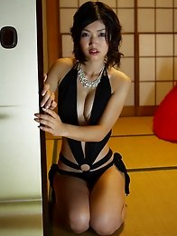 Sensual gravure idol babe seduces in her slinky gold lingerie