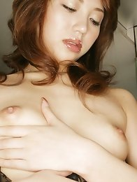 Gorgeous asian beauty in lingerie plays with her plump titties