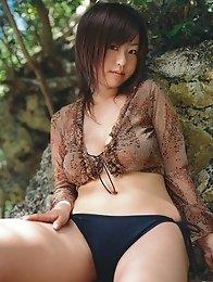 Delicious gravure idol babe with plump perky tits in a bikini