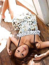 Sweet and beautiful Japanese av idol Natsuki Yoshinaga shows her tanned body
