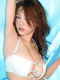 Beautiful asian chick with big bouncy boobs in a tight bikini