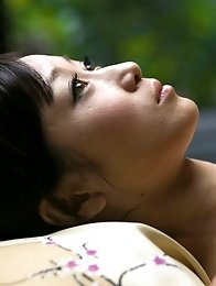 Sexy and mature Japanese av idol Yu Kawakami lies down to get a sexual naked massage