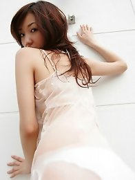 Busty asian beauty showing off her delicious tits in lingerie