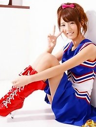 Spunky gravure idol jumping up and down as a cheerleader
