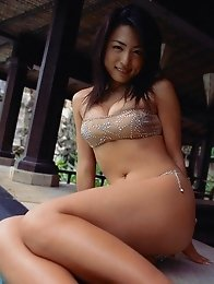 Yukie Kawamura is all wet in her tiny red bikini