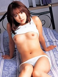 Cute gravure idol taking off her lingerie to show her nude tits