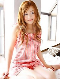 Beautiful gravure idol angel in a cute short dress and boots