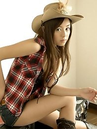 Adorable asian cowgirl tempts in her boots and jean shorts