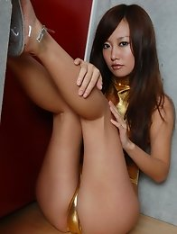 Saucey asian babe shows off her delicious legs in high heels