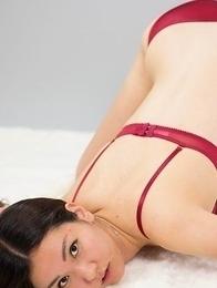 Red lingerie babe Madoka Yukishiro shows her beautiful legs on a big bed
