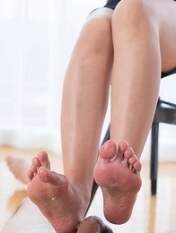 Short-haired brunette Kuroki Ayumi jerking a guy's cock with her sexy feet/toes