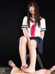 Schoolgirl seductress Aino Neko casually jerking a cock with her soft feet