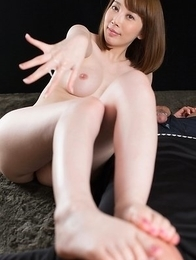 Short-haired hottie Aya Kisaki fucks him with her sexy feet and makes him cum
