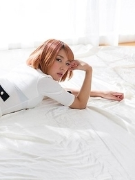 Chie Kobayashi laying on a beautiful bed while brazenly showing her legs/feet