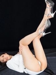 Beauty in white Natsuki Yokoyama giving a sensational footjob on camera