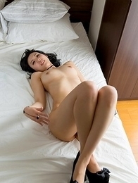 Perky tits brunette Natsuki Yokoyama posing and exposing her beautiful bush