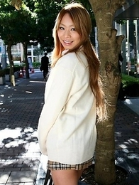 Remika Uehara poses on the street