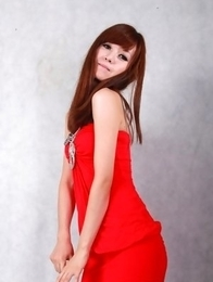 Sandy on heels shows hot behind in red dress for pictures