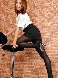 Rina Itoh in office suit exposes sexy legs in pantyhose