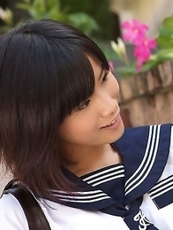 Japan teen Yuzuki Hashimoto in sailor gal uniform is playful outdoor