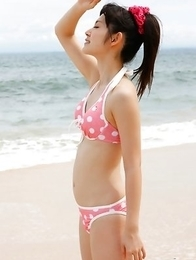 Airi Suzuki in cute bath suit enjoys hot sand on her curves