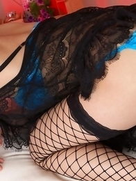 Kana Yuuki in fishnets has fine curves in blue bath suit