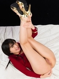 Brunette in red Moeka Kurihara teasing you with her juicy barely legal pussy on a bed