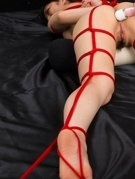 Hot babe Reo Saionji is teased with a sex toy while being tied up with a red rope