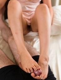 Short-haired Japanese seductress Ayano Hidaka giving a great footjob/toejob on cam