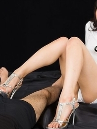 Hottie in white Natsuki Yokoyama teasing that cock with her feet and hands